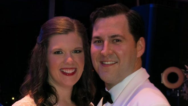 Newlyweds Emily Settle and Chris Merckle dance at their wedding reception.
