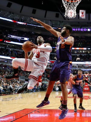 Chicago Bulls' Dwyane Wade (3) drives on Phoenix Suns' Alan Williams (15) during the second half of an NBA basketball game Friday, Feb. 24, 2017, in Chicago. The Bulls won in overtime 128-121.