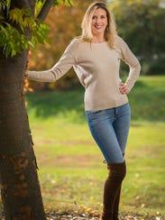Laura Rowe wearing her favorite skinny, patchwork/distressed