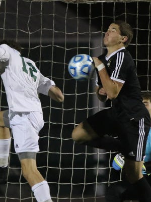 Eddie Kraebel of Ramapo heads the ball into the goal past defender Dante Bettino of Hopewell Valley to win the game for Ramapo in overtime.