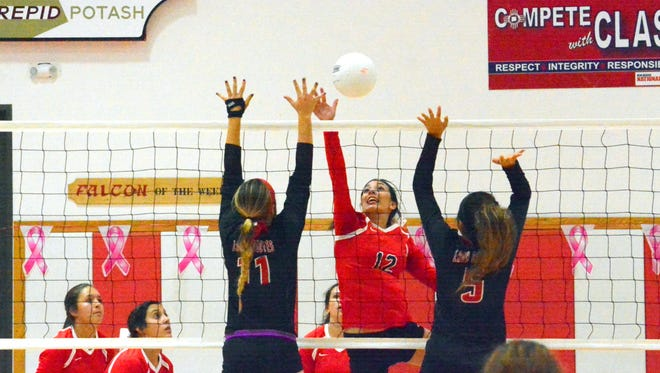Loving's Katelynn Rubio with a kill attempt in the first set Thursday.