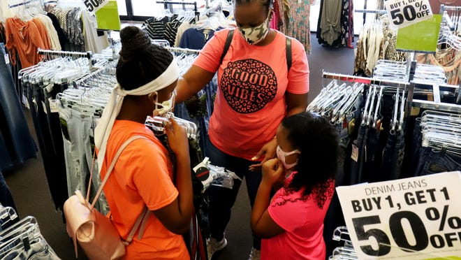 In Arkansas, Tax-free Weekend will begin on Saturday, Aug.7 at 12:01 a.m. and end onAug.8 at11:59 p.m. In Oklahoma,the sales tax will be exempted from Aug.6-8.Shara Kang and Daimya Parker, left, are seen with Keslyn Kang, at Van Buren's Factory Connection in the Town North Shopping Center during the 2020 Tax-Free Weekend in Arkansas.