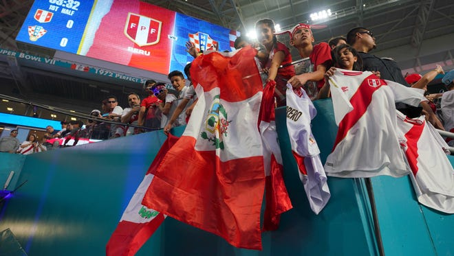 Fans of the Peruvian national team waive flags prior to the match between Peru and Croatia at Hard Rock Stadium in Miami on March 23, 2018.