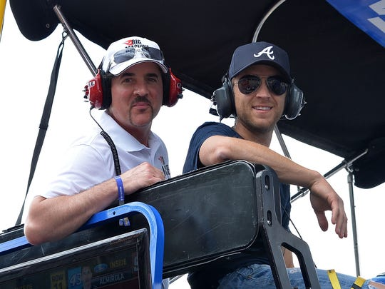 Big Machine Records CEO and President Scott Borchetta and Justin Moore in the 99 Carl Edwards Pit during Brickyard 400 Presented By Big Machine Label Group at Indianapolis Motorspeedway on July 28, 2013 in Indianapolis, Indiana.