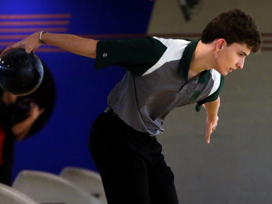 Montville senior Erik Kattermann bowls during a Morris