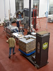 Fresh cans of Ripple come off the canning line Wednesday,