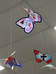 Fifth-graders at Central School decorated and hung colorful butterflies as part of a language arts unit that used a book of poetry written by children interned in the Terezin concentration camp during World War II.