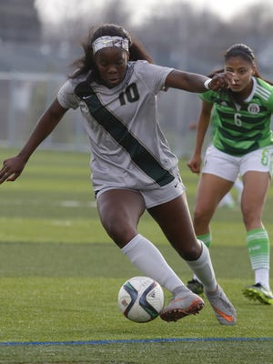 Michigan State's Kristelle Yewah (10) controls the ball in front of U-20 Mexico National's Nancy Antonio (6) April 18, 2016, in Lansing, Mich. The Okemos native is one of the top goal scorers for Michigan Chill SC of the Women's Premier Soccer League.