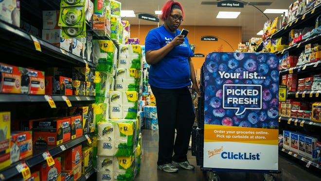 January 12, 2017 - Natashia Ingram, a ClickList dedicated associate, finds grocery items for customers as she walks down an aisle at the Kroger grocery store, located at 799 Truse Parkway, in East Memphis on Thursday. Kroger has the new ClickList shopping program where customers can shop online and place an order. Then, a Kroger employee will do the shopping, and the customer can pick up their order at the store. (Yalonda M. James/The Commercial Appeal)