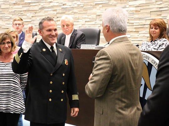 Westland Fire Chief Michael Stradtner being sworn in