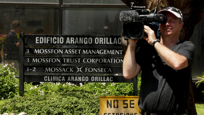 "A cameraman films outside the Arango Orillac Building that lists the Mossack Fonseca law firm in Panama City, Tuesday, April 5, 2016. Millions of confidential documents were leaked from the Panama-based law firm, coined the ""panama papers,"" revealing details of how some of the globe's richest people funnel their assets into secretive shell companies set up here and in other lightly regulated jurisdictions."