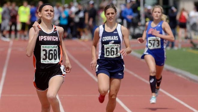 Macy Heinz of Ipswich wins the girls class B 400 meter dash at the state track meet at Howard Wood Field, May 25, 2013.
