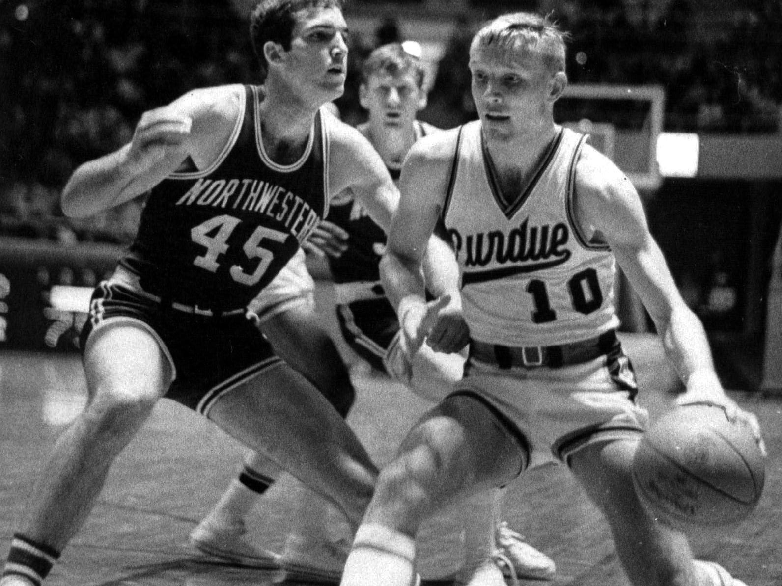 Rick Mount Purdue's high scoring sophomore cuts to the basket around Northwestern's Mike Weaver in Feb. 51968 Big 10 battle at Lafayette Ind. Mount scored 30 points as Purdue won 98-89 knocking the Wildcats from first place. (AP photo/s)