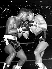 Sugar Ramos (right) trades punches with Davey Moore during a fight in Los Angeles in 1963.