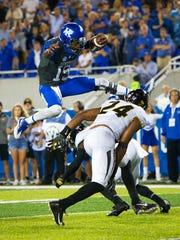 Kentucky quarterback Stephen Johnson leaps over Missouri