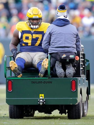 Green Bay Packers nose tackle Kenny Clark (97) is carted off the field after getting injured against the Baltimore Ravens Sunday, November 19, 2017, at Lambeau Field in Green Bay, Wis.