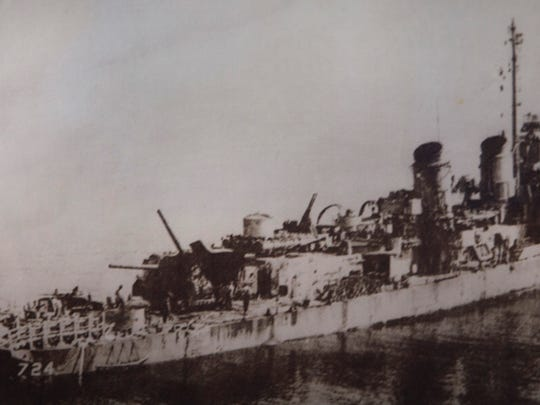 This photo of the Laffey after Okinawa hangs on Bill Kelly's wall.