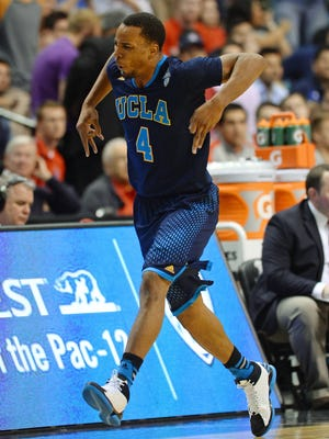 UCLA's Norman Powell reacts after scoring against the Arizona Wildcats during the championship game of the Pac-12 Tournament.