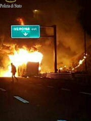 Flames engulf a bus that crashed near Verona, northern Italy, Saturday, Jan. 21, 2017. Police say 16 people have died when the bus carrying Hungarian school students returning home from France crashed into the side of a highway near Verona. Thirty-nine people survived. The bus was returning to Budapest with students ages 15 to 17.