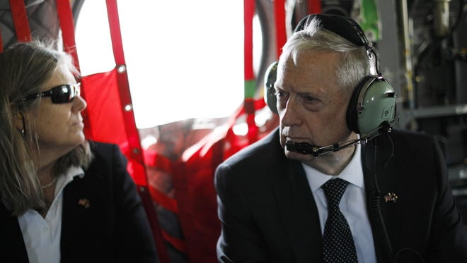 Defence Secretary Jim Mattis and senior adviser Sally Donnelly arrive by helicopter at Resolute Support headquarters in the Afghan capital Kabul on April 24, 2017.