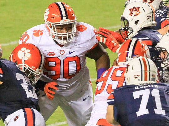Clemson defensive lineman Dexter Lawrence (90) closes in on tackling AuburnÕs Kerryon Johnson (21) during the first quarter at Jordan-Hare Stadium in Auburn, Alabama.