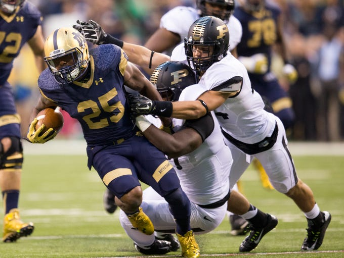 Tarean Folston, of Notre Dame, rushes during first quarter action, Purdue and Notre Dame football at Lucas Oil Stadium, Indianapolis, Saturday, September 14, 2014.