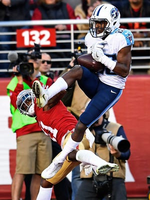 Titans cornerback Adoree' Jackson (25) lets an interception slip his grasp over 49ers wide receiver Marquise Goodwin (11) in the second half at Levi's Stadium, on Sunday, Dec. 17, 2017 in Santa Clara, Calif.