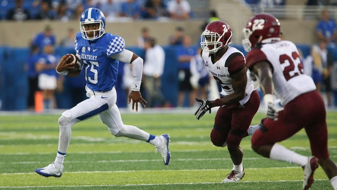 Kentucky quarterback Stephen Johnson runs the ball in the second half of an NCAA college football game against New Mexico State Saturday, Sept. 17, 2016, in Lexington, Ky. Kentucky won the game 62-42.