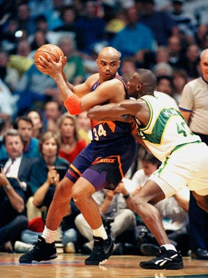 Charles Barkley, left, of the Phoenix suns backs in on Shawn Kemp (40) of the Seattle SuperSonics during their NBA Western Conference playoff game in Seattle, June 4, 1993. Seattle beat Phoenix 118-102 to even the best-of-seven series at 3-3.