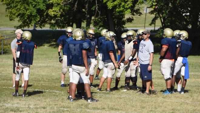 Beacon High School head football coach Brian Mahon talks to his players during preseason practice on Wednesday.
