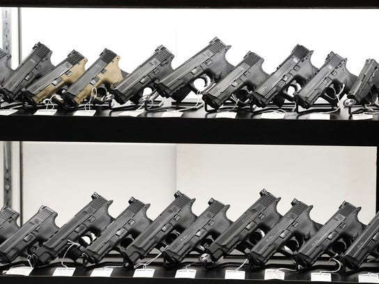Guns for sale at Nashville Armory, April 2, 2015. A bill under consideration by a Tennessee House committee would create a sales-tax holiday for firearms sales.