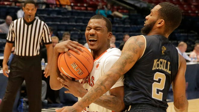 UTEP guard Lee Morre, pulls up and gets the foul called against FIU's guard Donte McGill during first half action i ntheir gsme Wednesday night. The MIners were able to hold on with a late surge 85-77 and will now takeon the Thundering herd from Marshall Thursday night at 7;30 p.m. MST>