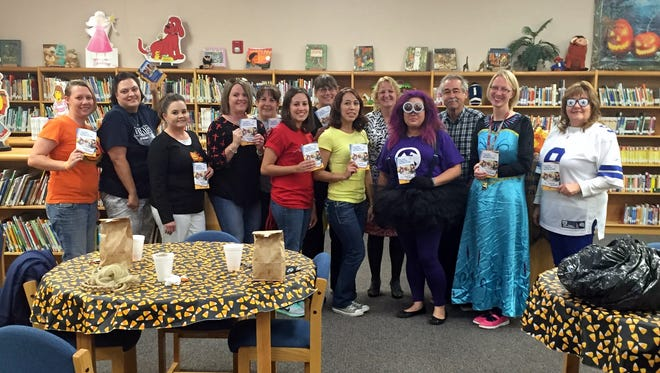 """After a school-wide costume contest at Memorial Elementary School on Friday, Oct. 30, teachers met for Teacher Appreciation. Memorial was the school chosen this year to be rewarded by Walmart. The superstore gave out twenty $50 gift cards for a total reward of $1,000. The teachers plan to use the money for student materials in their respective classrooms. The teachers who received the gift cards are:  Marybeth Juarez, Natalie Nicole, Shannon Treadwell, Sylvia Verdugo, Sylvia Orquiz, Adam Perrault, Dane Williams, Kenna Barnes, Liz Nevarez, Adrienne Elliott, Irma Dominguez, Cindy Brodbeck, Blanca Diaz, Marisela Hidalgo, Veronica Lozano, Roberta Holguin, Paloma Fix, Jane Medin, and Paul Hoylen. Memorial School would like to say, """"Thank you."""""""