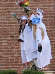 Hanover Park High School graduates celebrate after commencement.