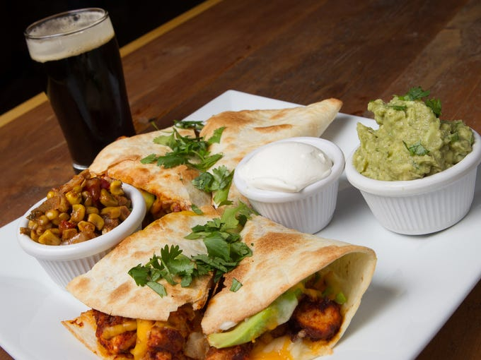 Chicken Quesadilla and a small draft beer at Ambulance Brew House in Nanuet on Sunday, Sept. 7, 2014.