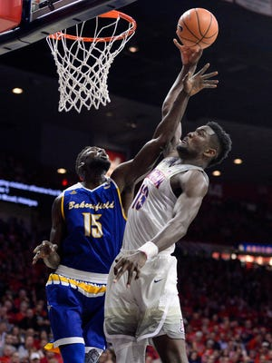 Arizona Wildcats forward Deandre Ayton (13) shoots the ball as Cal State Bakersfield Roadrunners center Fallou Ndoye (15) defends during the first half at McKale Center.