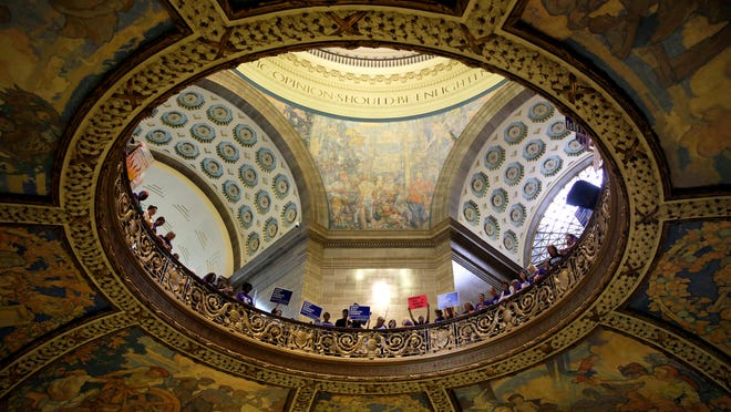 Abortion rights activists hold signs inside the Missouri Capitol Wednesday in Jefferson City, Mo.