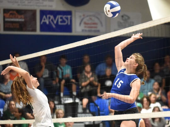 Cotter's Kate Cheek hits for one of her 13 kills against