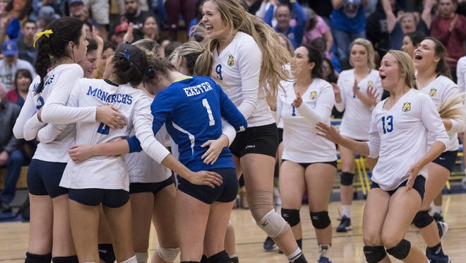 Exeter celebrates their win over Redwood in a Central Section Division II semifinal volleyball playoff game on Tuesday, November 8, 2016 in Exeter.