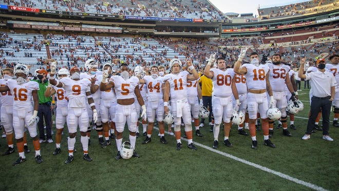 "Texas Longhorns sing ""The Eyes of Texas"" on Oct. 24 after beating the Baylor Bears 26-16 at Darrell K Royal-Texas Memorial Stadium."
