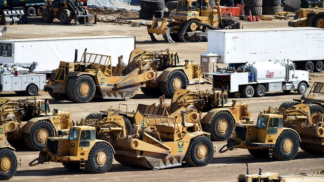 Andy Barron/RGJEquipment is lined up Thursday at the Tesla gigafactory under construction at the Tahoe Reno Industrial Center. The Tesla gigafactory under construction at the Tahoe-Reno Industrial Center on Feb. 5, 2015.