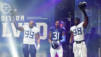 Tennessee Titans defensive tackle Jurrell Casey (99), safety Kevin Byard (31), and linebacker Brian Orakpo (98), show off their new uniforms during the Titans uniform reveal event held at Broadway and 1st Avenue in Nashville, Tenn., Wednesday, April 4, 2018.