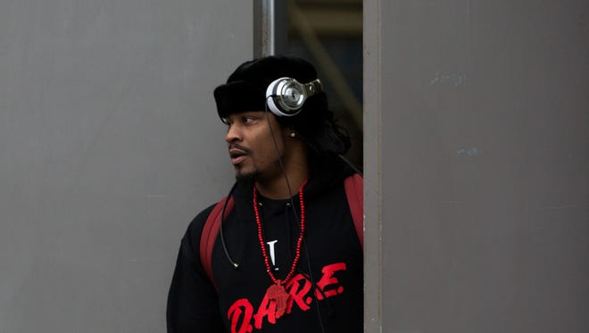 Seattle Seahawks running back Marshawn Lynch leaves the Virginia Mason Athletic Center to board a bus to travel to the team's NFL football game Sunday against the Carolina Panthers, Friday, Jan. 15, 2016, in Seattle.