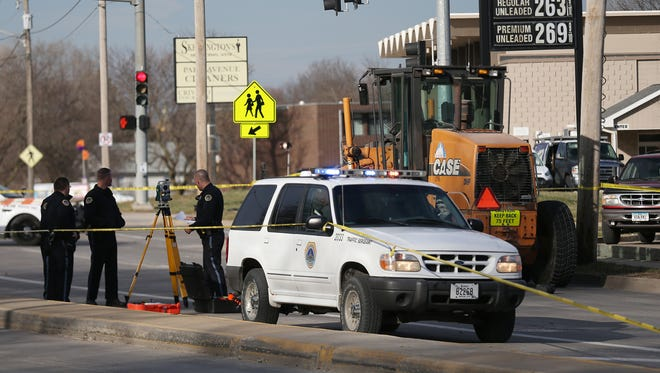 The Des Moines Police Department investigates the scene where a 16-year-old boy was killed while crossing Southwest Ninth Street outside of Lincoln High School after being hit by a grader on Thursday afternoon, March 9, 2017, in Des Moines.