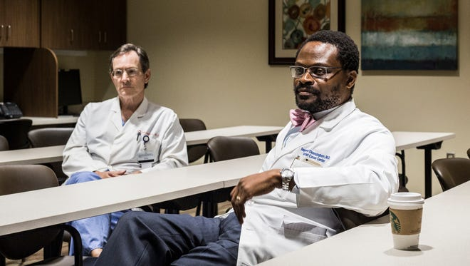 July 12, 2017 - Dr, Todd Robbins, left, and Dr. Raymond Osarogiagbon, right, co-directors of the multidisciplinary thoracic oncology program with the Baptist Medical Group. The program at Baptist Memorial Hospital facilities, with help from a $900,000 grant to fund an experimental process, has detected dozens of cases of lung cancer during the past 18 months in the very early stages, while they're still highly treatable.