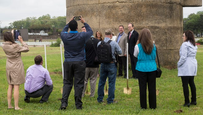 April 24, 2018 - Brian Hill, Silo Square developer and owner, left, and Secretary of State of Mississippi Delbert Hosemann, right, pose for pictures after the groundbreaking ceremony for Silo Square in Southaven. The Silo Square development located on farmland between Getwell and Tchulahoma roads south of Goodman calls for a mixture of residential, commercial and public uses built around a central Main Street boulevard.