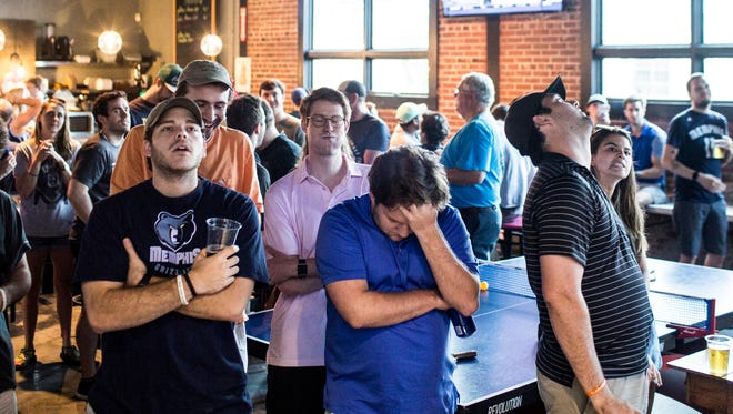 May 15, 2018 - Memphis Grizzlies fans, from left, Frederick Scharff, John Brand, and Conner Forrester react after seeing the Grizzlies receive the 4th pick in the 2018 NBA Draft.