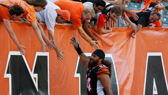 Bengals defensive tackle Domata Peko celebrates Sunday's 33-7 win with fans at Paul Brown Stadium.