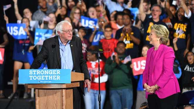 Democratic presidential candidate Hillary Clinton and Sen. Bernie Sanders campaign in Raleigh on Nov. 3, 2016.