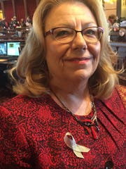 Sen. Pam Jochum, D-Dubuque, wears a silver ribbon to show solidarity with Iowa public employees during a debate on a collective bargaining bill. Many Democratic lawmakers are wearing similar silver ribbons at the Iowa Capitol.